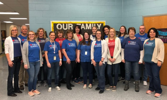 Shell Creek staff members in I Love Public Schools tshirts