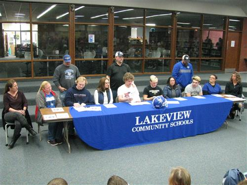 Football Players Sign Their Letter of Intent
